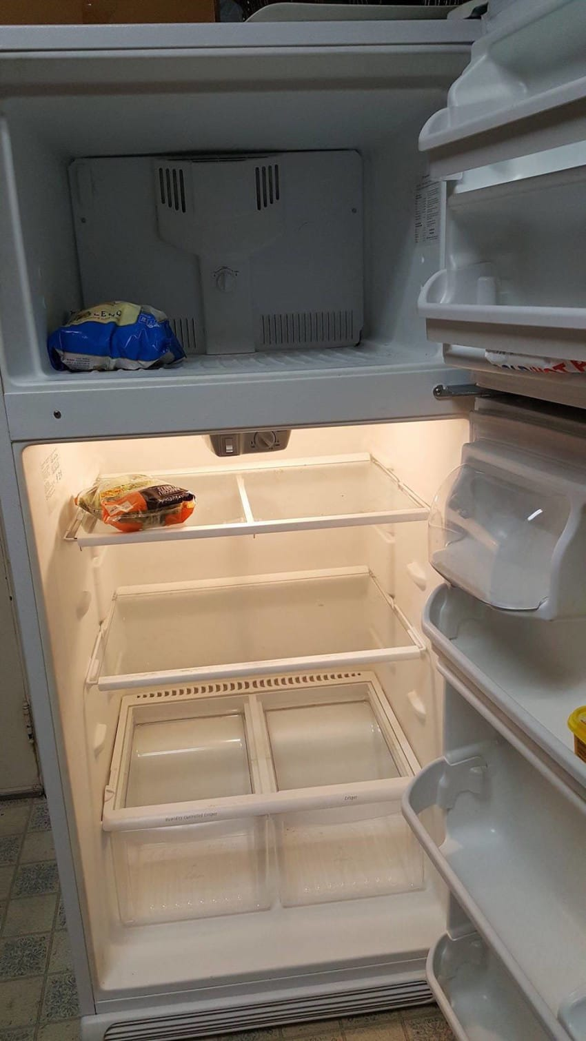 man with empty fridge