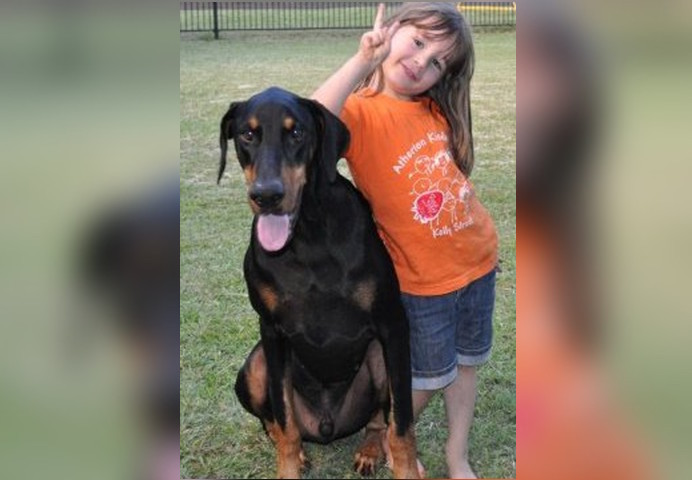 Horrified Parents Watch Adopted Doberman Grab Their