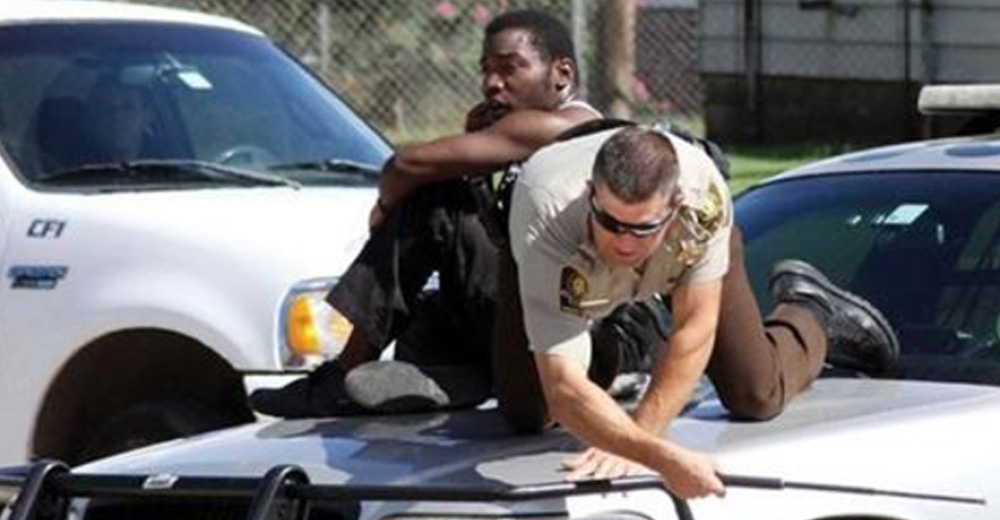 Man And Cop Climb On Top Of The Police Car After Coming