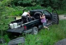couple dumping trash wildlife preserve