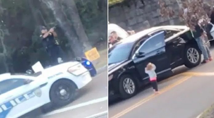 toddler walks towards police hands up