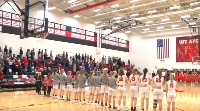 Players Freeze National Anthem Song