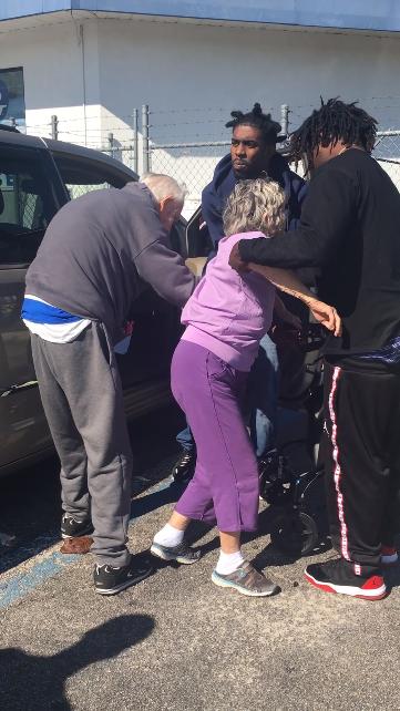 3 Young Men Help Shaky Elderly Couple