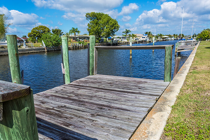 Old Weathered Boat Dock on a Canal in Florida
